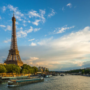 beautiful sunset over eiffel tower and seine river with puffy clouds,