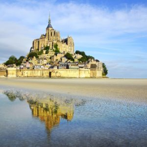 landscape with mont saint michel abbey normandy, france